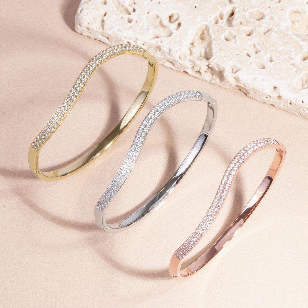 Mia Jewelry_Pulseira wave com zircónias cúbicas em aço_ PVP 52€, dourado e rose gold_ PVP 54€_resize